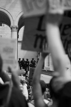 Chaos in Covid, black and white photograph of protestors and police