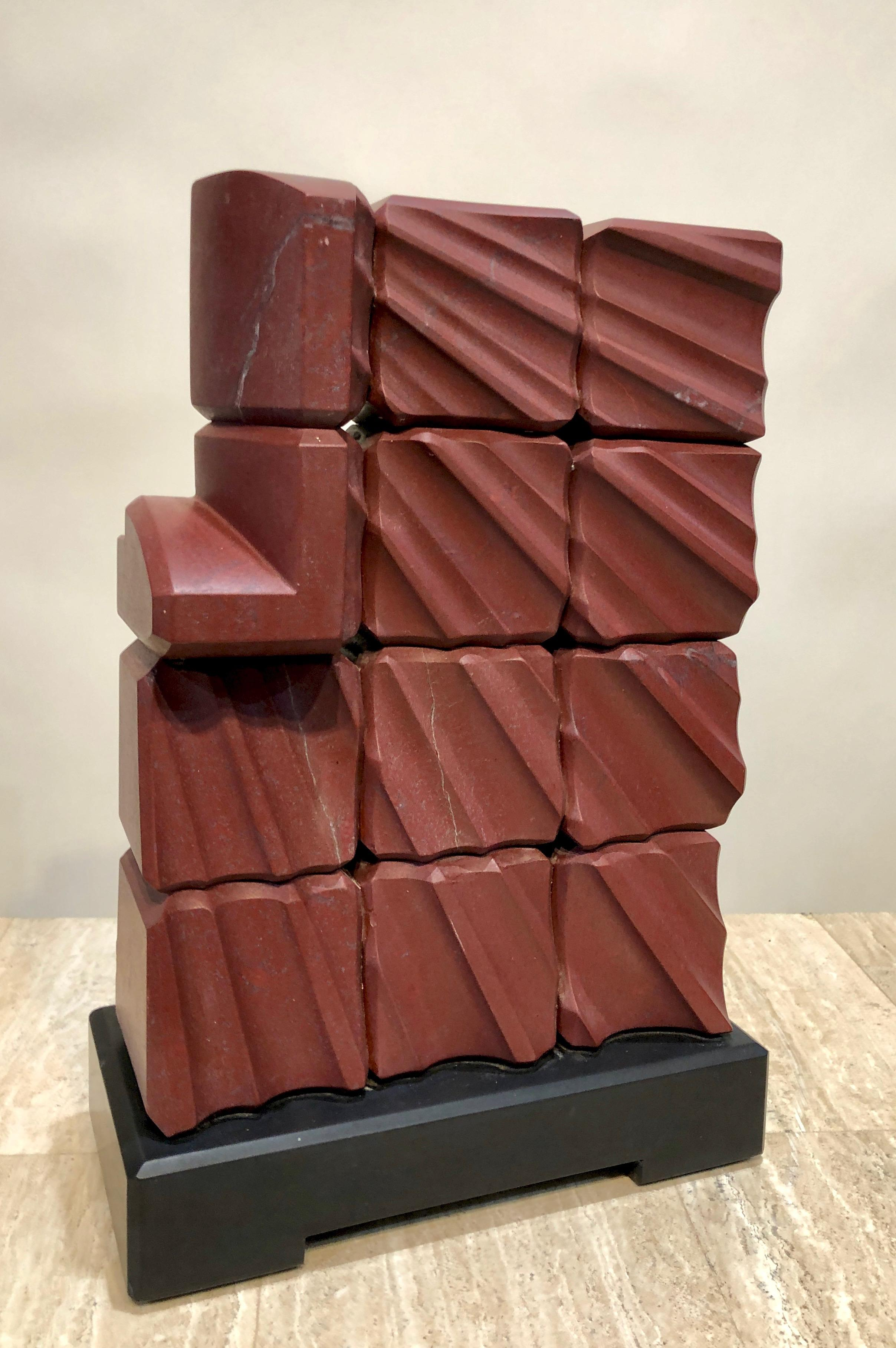 Red Ray, abstract sculpture, red Turkish Marble, black stone, geometric, carving
