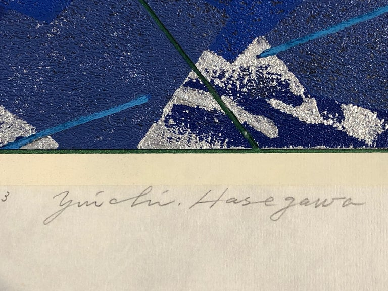 Mountains and Rivers, Japanese woodcut print, 10/20, blue, silver, black, white  Hasegawa Yuichi creates lush, textural prints using a unique woodblock technique: instead of carving one block for each color, the traditional manner, the artist