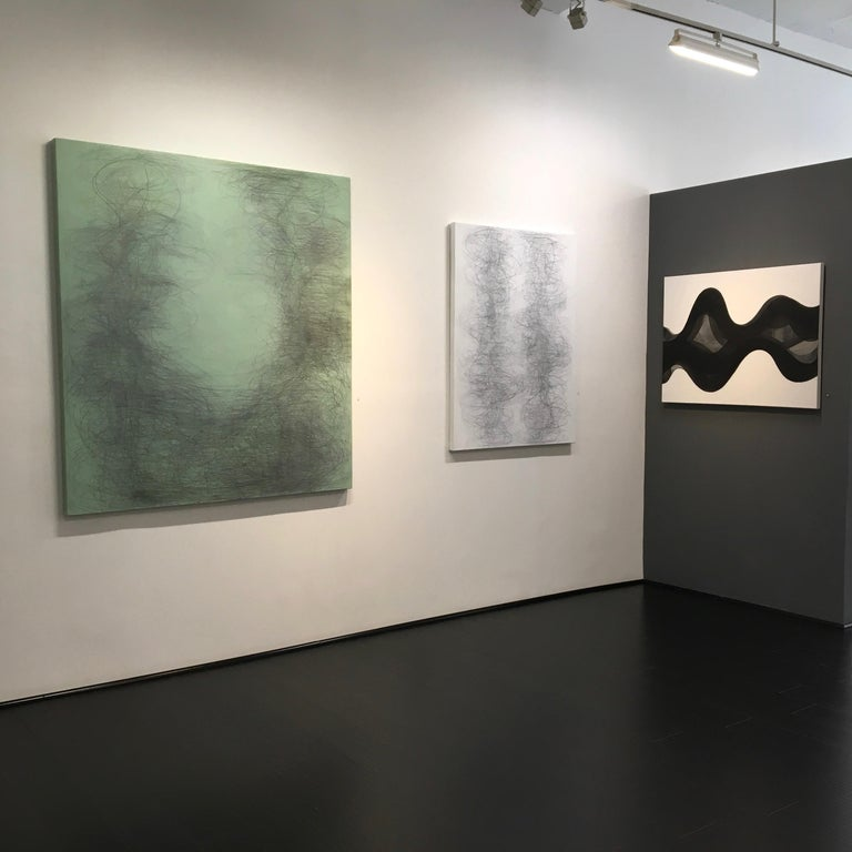 Margaret Neill's vertical abstract geometric drawing in graphite and acrylic on canvas titled Gamut investigates the properties of abstract curvilinear forms found in the localized conditions of her surrounding environment. This experience is