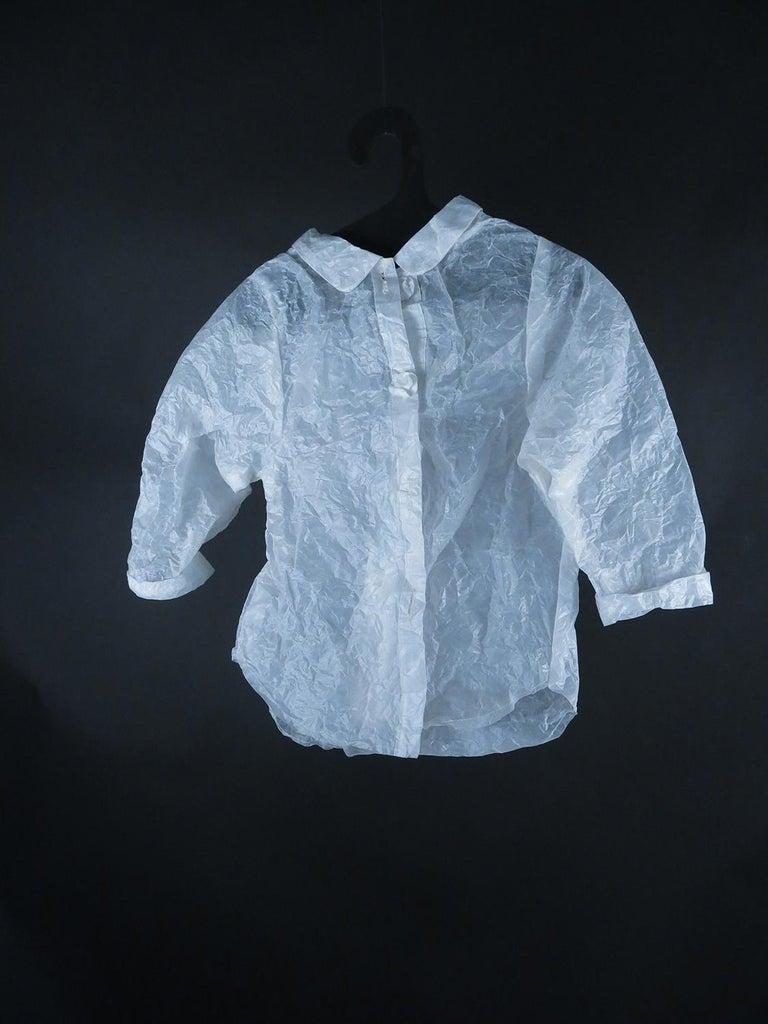 Kate Hamilton Figurative Sculpture - Child's Shirt (Figurative White Glassine Paper Sculpture of Clothing Garment)
