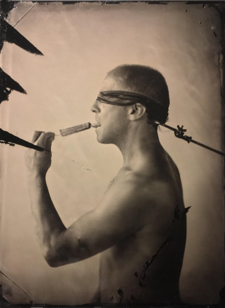 David Sokosh Figurative Photograph - Linguist (Salacious Tin Type Photo of Male Nude Licking an Ice Pop, blindfolded)