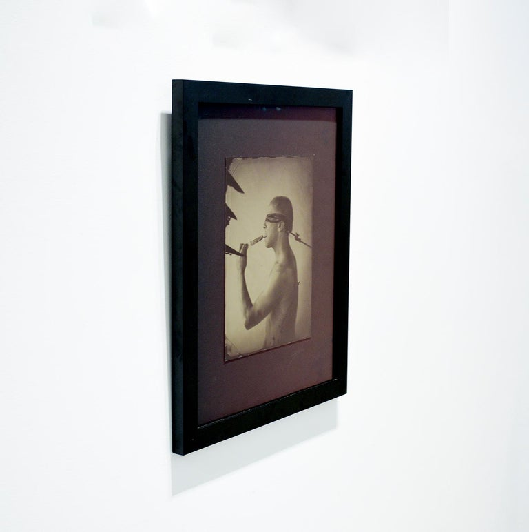 Linguist (Salacious Tin Type Photo of Male Nude Licking an Ice Pop, blindfolded) - Brown Figurative Photograph by David Sokosh