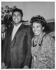 Icons, people - Muhammad Ali smiling with Lorraine Adams, Los Angeles, Aug 1964