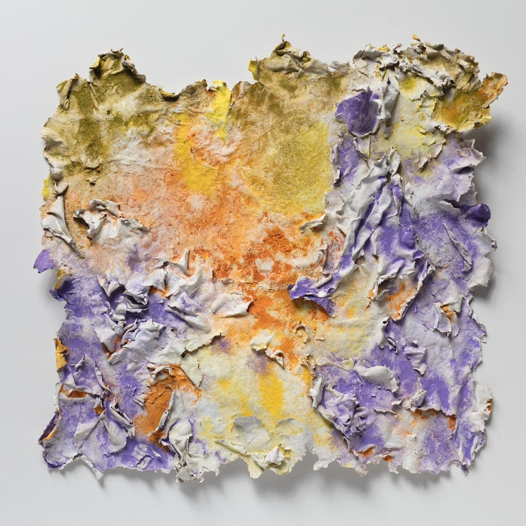 """Ruggero Vanni's """"Solstitium (Summer Solstice)"""" is a 18 x 17 inch abstract work on paper mounted in a 25 x 25 inch black frame shadow box. The hand made paper is very tridimensional, with orange, yellow, and purple accents of pure pigment.  A strong"""