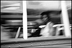 1999-New Orleans - Black and White Photograph of Woman on New Orleans Street Car