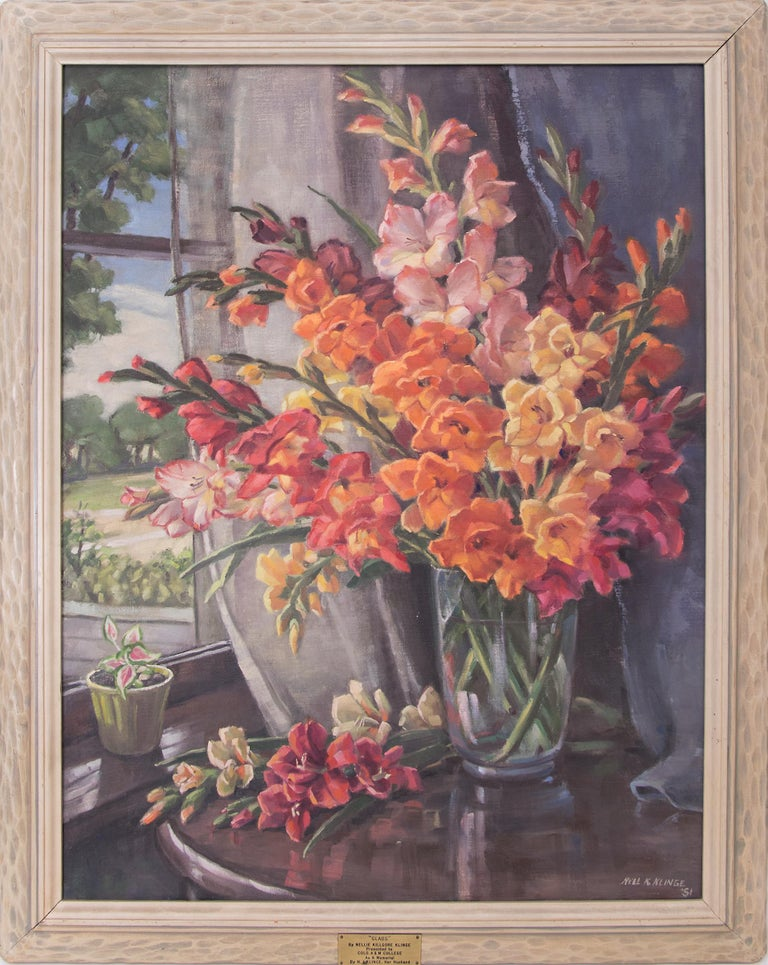 An original interior still life oil painting by Nellie Klinge (1883-1954) of a lively bouquet of gladiolas painted in the mid-20th century, 1951. Presented in vintage frame, outer dimensions measure 41 ½ x 33 ¼ x 2 inches. Image size is 36 ¼ x 28
