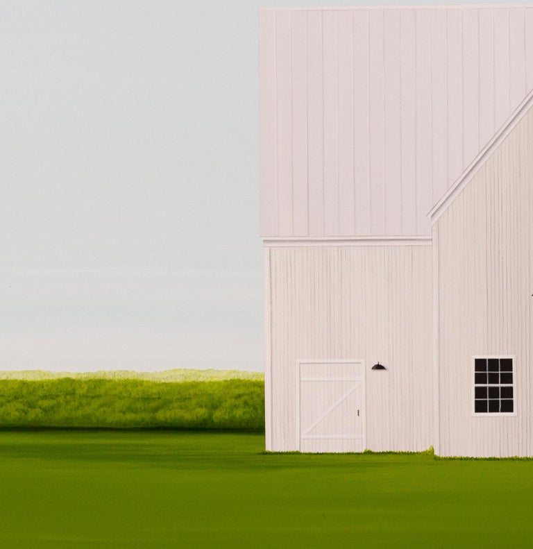 A white barn against a pale sky appears to float on a verdant green ground in this ethereal image by F. Lipari. Framed dimensions 38 x 50 inches.  Following a successful career as an art director for a graphic design and advertising firm in