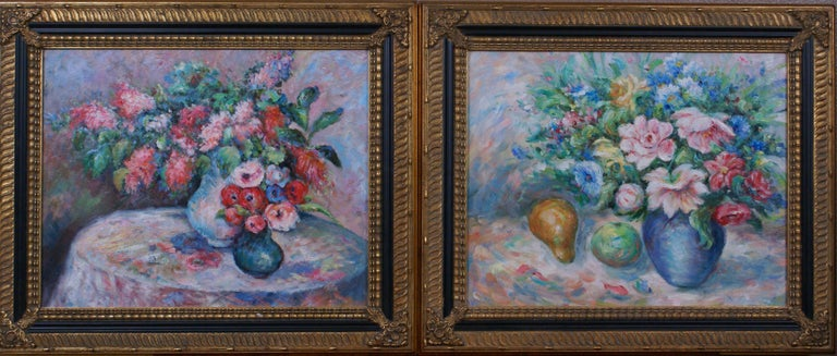 A pair of floral still life paintings. The first painting depicts two vibrant floral still lifes, one in a large white vase and the second in a small blue one, set on a round table. Oil on canvas measures 16 x 20; frame dimensions measure 21 1/8 x
