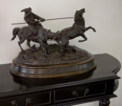Bronze sculpture of a horse catching Russian farmer signed by Yevgueni Lanceray