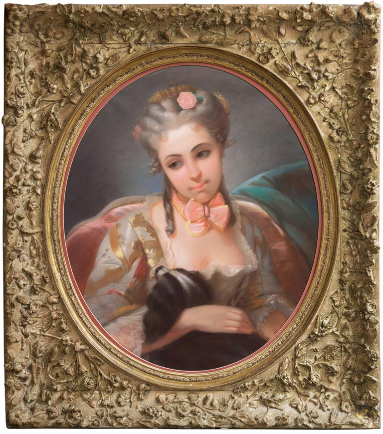 A substantial, late 19th century, French School portrait of an elegantly dressed young woman shown holding her pet English spaniel.  A substantial, Rococo Revival work of distinct quality and atmospheric charm displayed in a period ivory-gesso frame