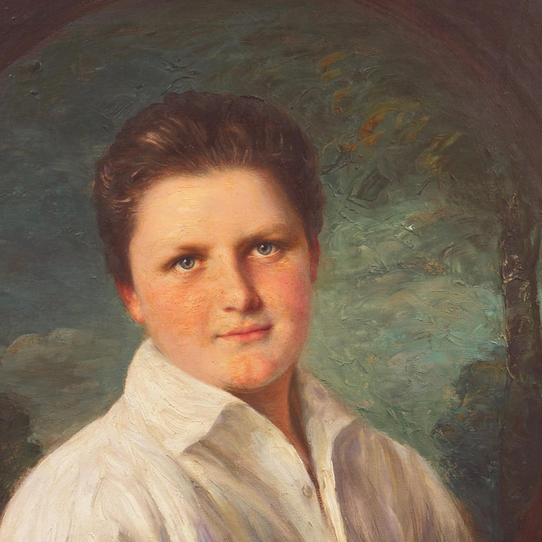 Signed lower left, 'A. Muller Ury' for Adolfo Felice Muller-Ury (Swiss-American, 1862-1947) and dated 1925.  A portrait of a young man with blue-green eyes wearing an open-neck shirt and gazing serenely towards the viewer.   Born in the Canton of