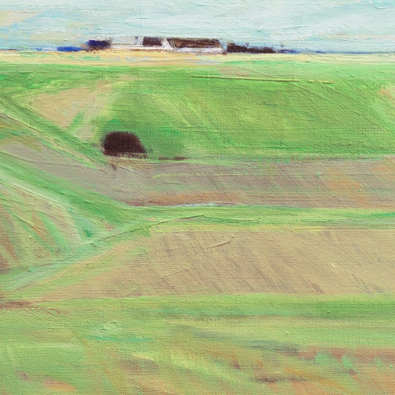 A poetic and painterly landscape showing a panoramic view of verdant fields with farm-buildings in the distance beneath swelling, light-suffused clouds.  Signed lower left with initials 'E.N.' for Erik Norgard (Danish, 1920-1997) and dated, verso,