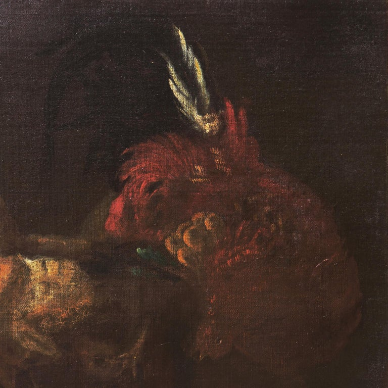 A substantial, 17th century French School oil showing a view of two cockerels fighting; painted circa 1650 by an accomplished animalier with a painterly hand and dramatic use of chiaroscuro.