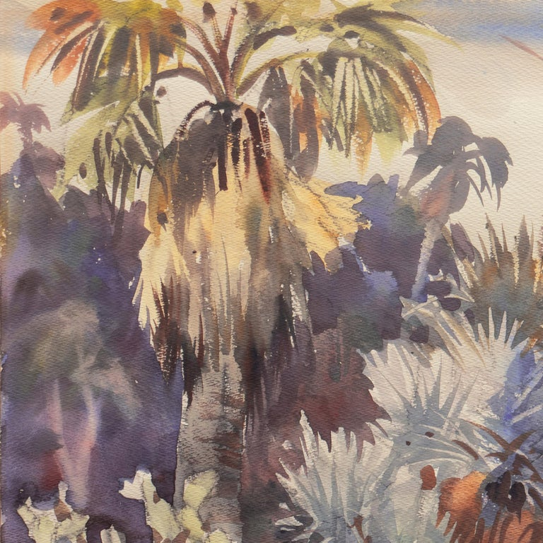 Signed lower right, 'R. Ledesma' for Ralph Ledesma (American, 1910-1993) and painted circa 1950.  An Impressionist style watercolor showing a view of a Southern California garden with palm trees and agave and other desert plants.   Ralph Ledesma was