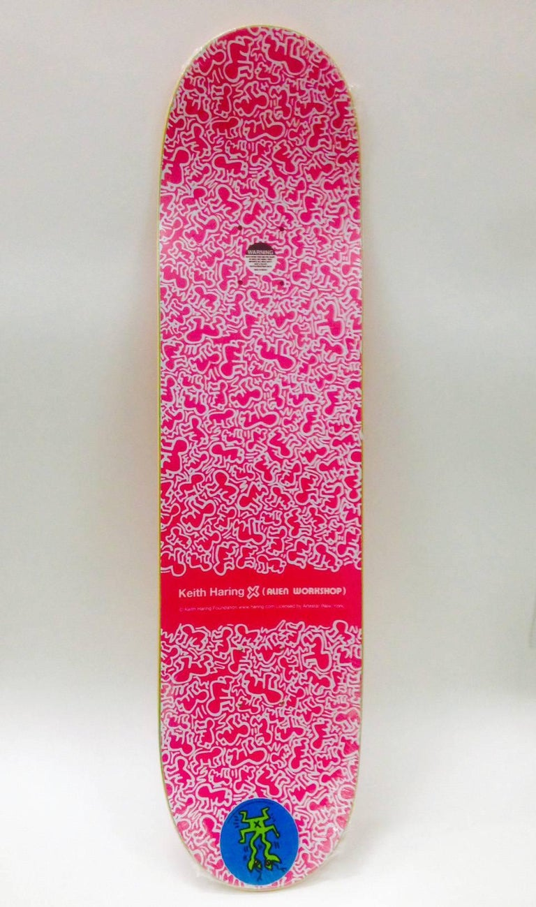 Rare out of print 2012 Keith Haring Skateboard Deck featuring one of the artist's iconic TV Head Men.  This work originated circa 2012 as a result of the collaboration between Alien Workshop and the Keith Haring Foundation. The deck is new and in