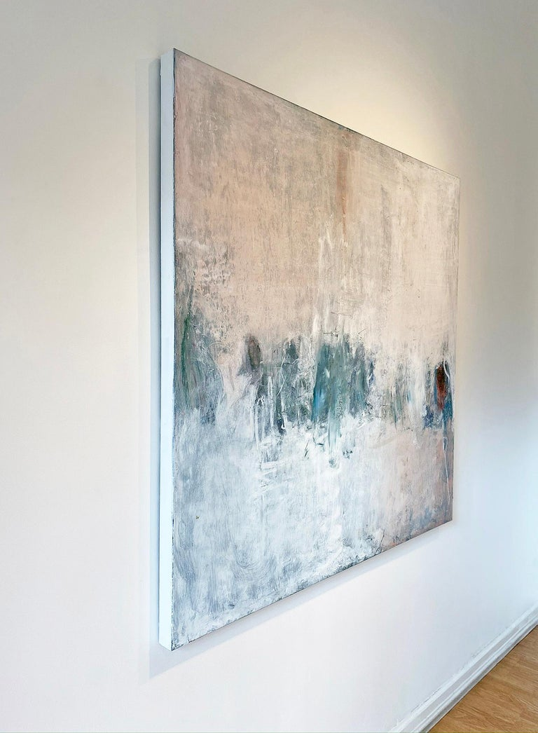 'Winter White Out' in 2019 by New York City base,  French artist Sandrine Kern. Oil and cold wax on canvas, 54 x 54 in. This abstracted landscape painting features a winter scene in colors of beige, white, peach, and hints of blue and