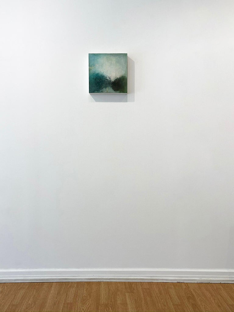 'Landscape I' in 2010 by New York City base, French artist Sandrine Kern. Oil and cold wax on canvas, 12 x 12 in. This abstracted landscape painting features a woodland scene in colors of varying hues of greens, blue, beige, brown, and