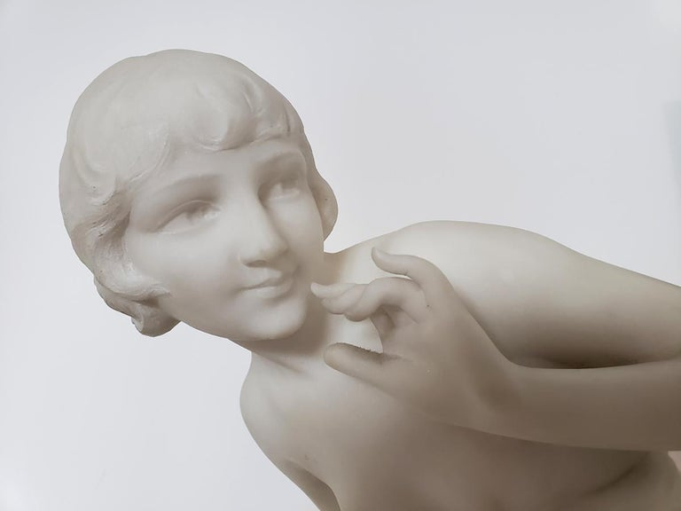 Deftly and elegantly craved marble of a partially drapped Art Deco beauty.   Signed C. Viviani on base.  Stunning!!!