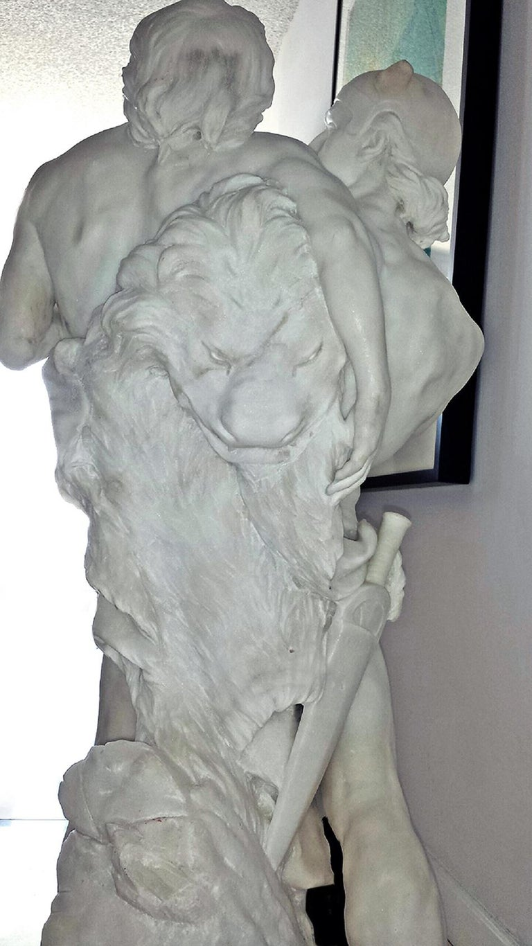 Signed and titled at the base, Sloan's Auctioneers, 1998 The work shows a peak moment of drama and   is meticulously carved in the neo-classical style. Lion garment in the back with lion face suggests that this is a reference to classical
