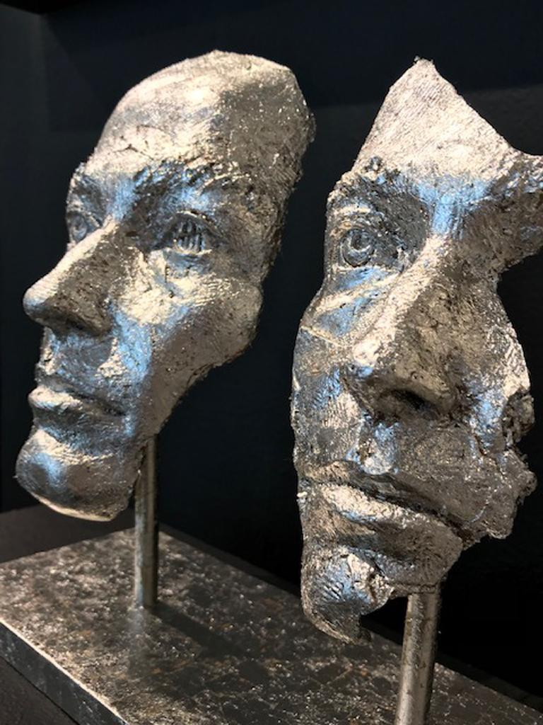 Bronze with Platinum Leaf  Based on Boky Hackel-Ward's self-portrait, this sculpture is not only about what can happen to us when we get lost in a love that seems to be grander than grand and we lose our own identity. It is also about women's place