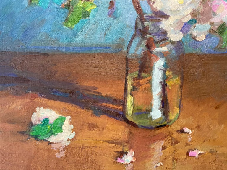 An oil painting of apple blossoms in a glass mason jar. Set on a wooden tabletop against a teal turquoise backdrop, heavy with notes of the painters brush.  Tim McGuire Born in 1971, Tim McGuire grew up in Buffalo, NY.  After teaching kindergarten