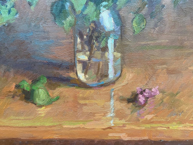 """An oil painting of lilacs in a mason jar. Painted from direct observation.   As a classically-trained painter, McGuire has all the tools to create a near-exact realist painting.  We see these skills shine in the accurately depicted """"Lilacs in a"""