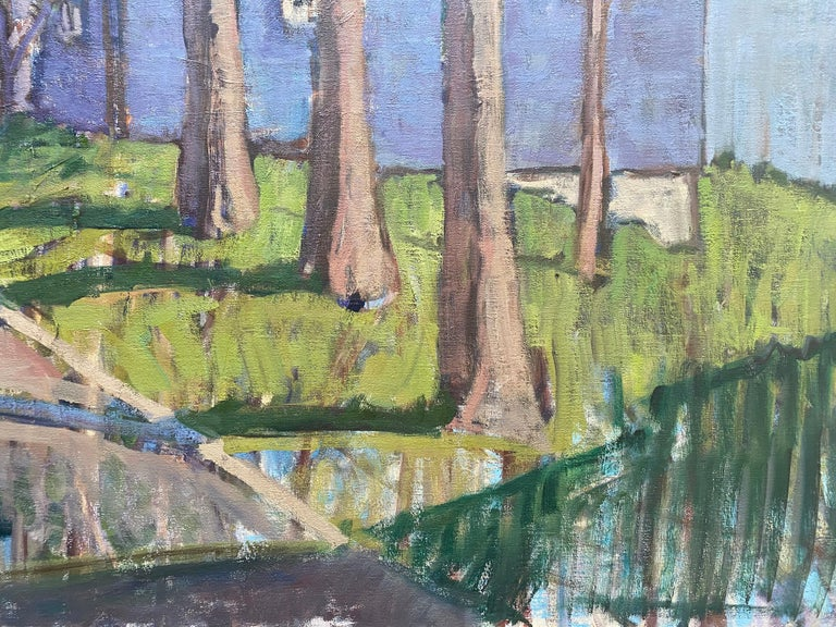 """""""Three Trees"""", is an oil painting of an ordinary residential street, lined with tall skinny trees. Houses are blocks of color, which diagonally recede along the street toward the horizon. A bright cerulean sky reflects onto the ground in both"""