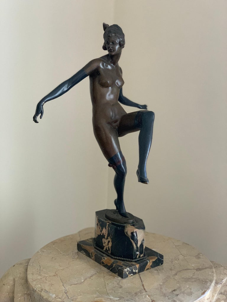 """A. TITZE  """"CABARET DANCER""""  BRONZE, SIGNED  AUSTRIA, C.1925  16.5 INCHES  A. Titze is a well known and prolific Austrian sculptor who made many figures of Art Deco dancing women."""