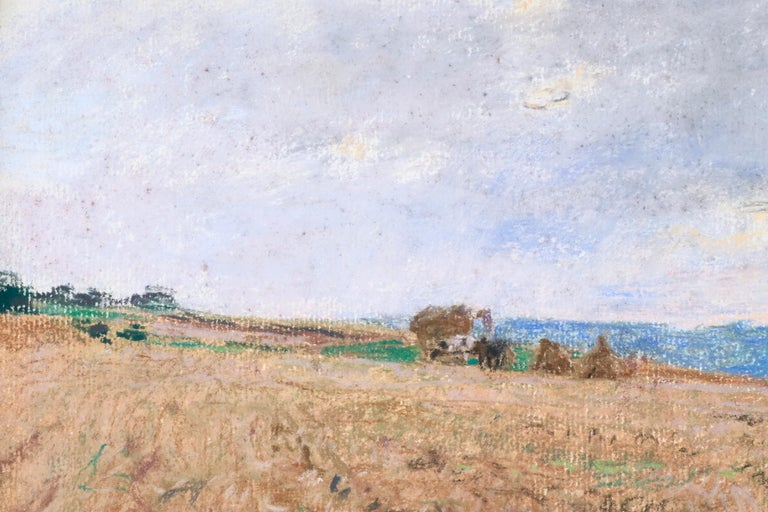 A turn of the century pastel on board by Léon Augustin Lhermitte depicting the golden scene of the field at harvesting. Signed lower left circa 1895.  Léon Augustin Lhermitte was the son of a school teacher. He painted from a very early age and
