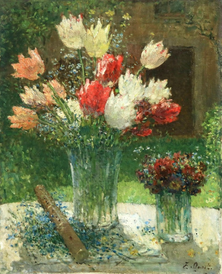 A really beautiful oil on canvas by French painter Ernest Quost depicting two vases of flowers - a larger vase in the centre holds red, white and pink tulips with a smaller vase to its side holding small wildflowers and there's a flute to the other