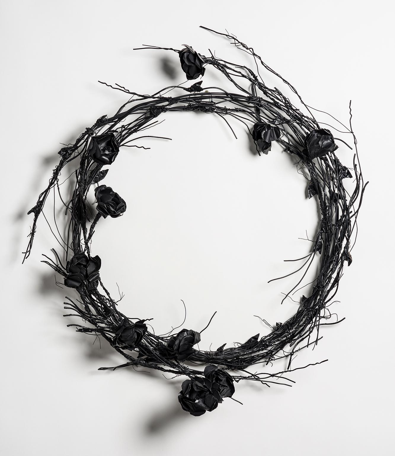 Sculpture of wire wreath with flowers: 'Mourning Wreath'