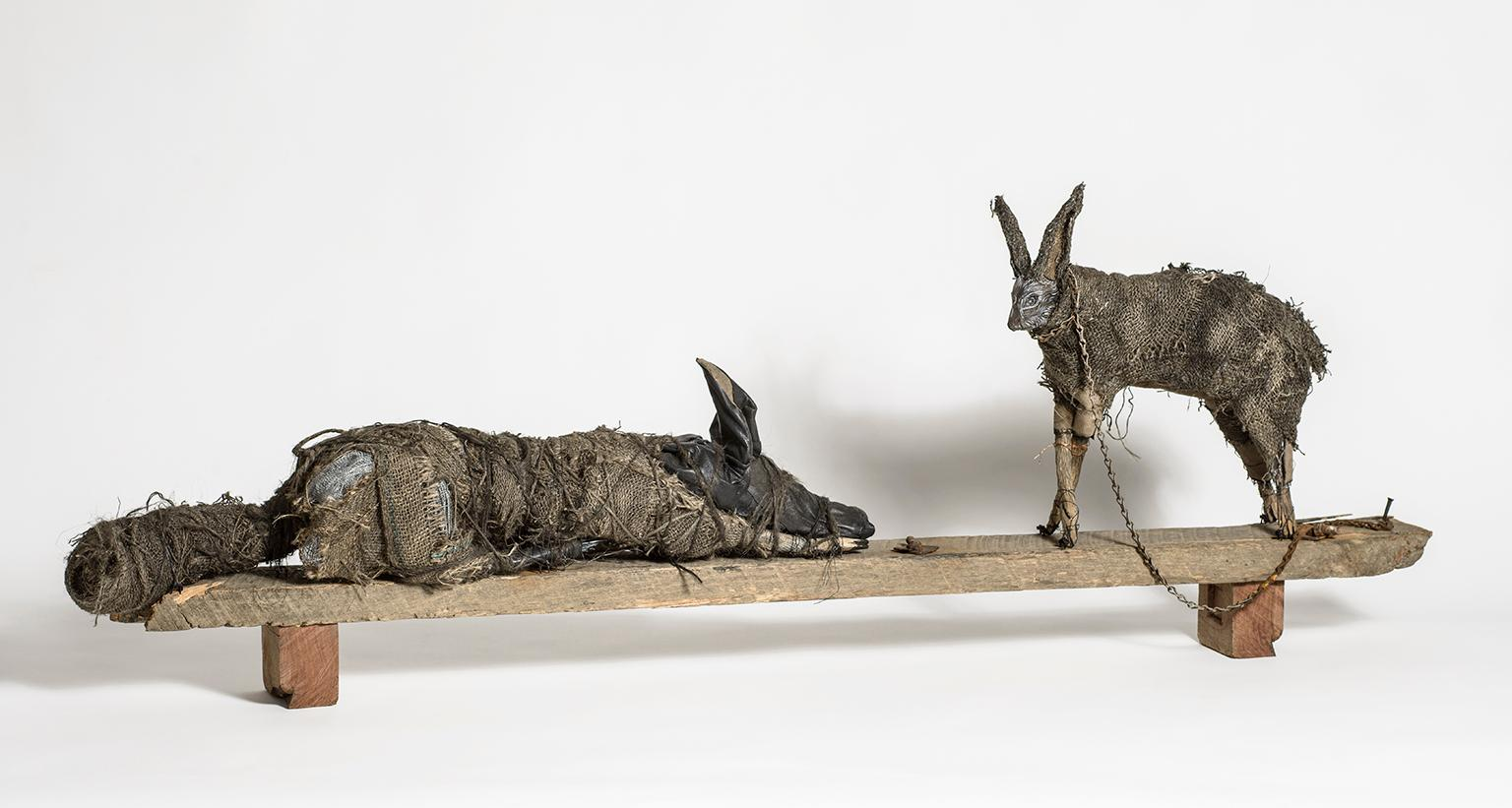 Sculpture of Rabbit and Dog on wood block, earth tone: 'Sisters'
