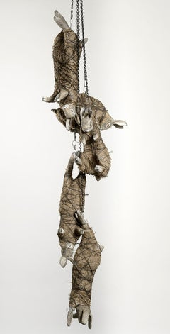Rabbits chained together, earth tone sculpture: 'The Moon Glazing Hare'