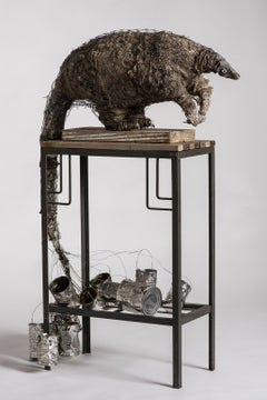 Anteater sculpture on high platform with tin cans: 'A Grim Fairy Tale'