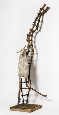 Sculpture of Rabbit crawling up wood ladder: 'Talking about Hard Things'