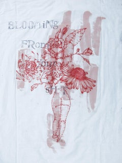 Painting on fabric with text: 'BLOOMING FROM YOUR SH*T'
