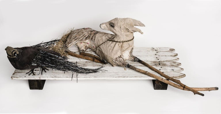 Elizabeth Jordan Figurative Sculpture - Canine and crow sculpture on fence: 'Philosophy Of The World'