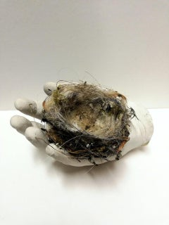 Sculpture of hand with nest: 'The Waiting'