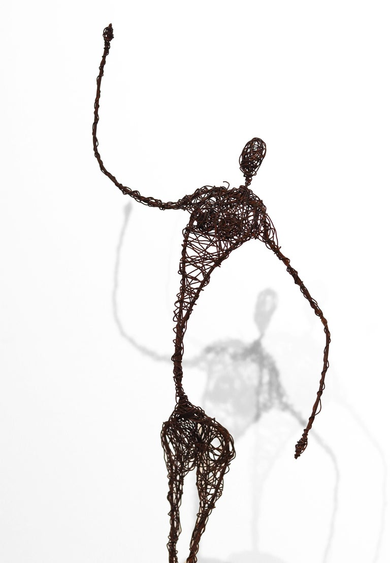 Susy Hunziker's metal figures are the result of exploring form, colors, and feelings, and reflect a love of life and aesthetics. Rust brown iron wire is wound meticulously in varying thicknesses, creating abstract sculptural figures. Her work is