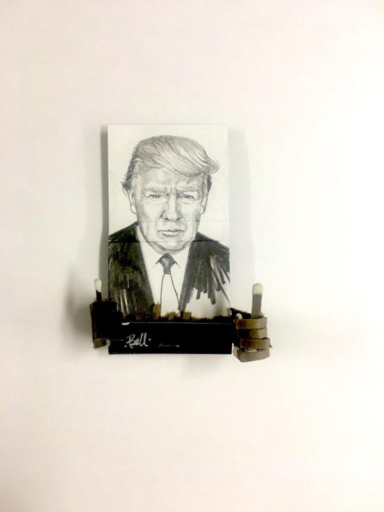 MB visual Portrait - Donald Trump- figurative black and white portrait drawing on matchbox