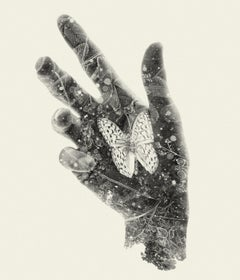 Resting Butterfly - black and white hand and nature multi exposure photograph