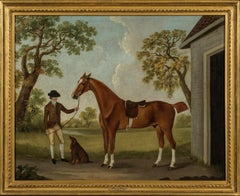 Hunter and Groom by a stable