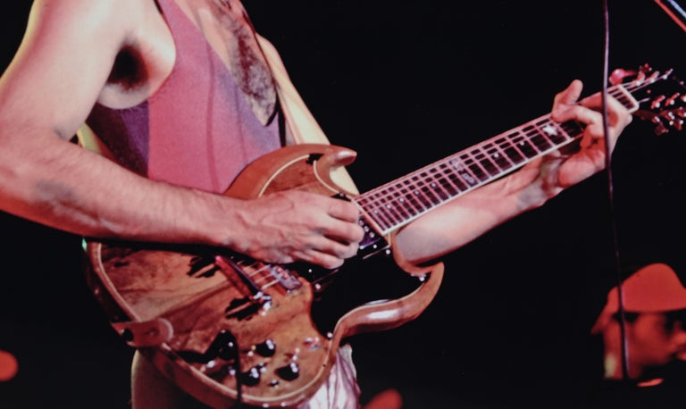 Frank Zappa on the Gibson SG - Photograph by Alan Herr