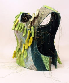 """Less"", mixed media, sculpture, ceramic, vest, green, brass, gold"