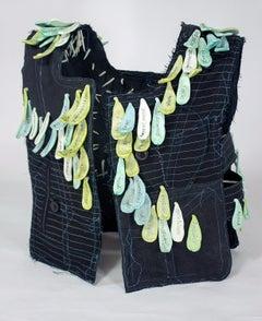 """Envy"", mixed media, sculpture, vest, ceramic, black, green, teal, white"