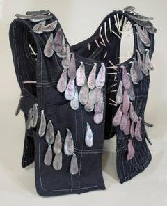 """""""Restraint"""", mixed media, sculpture, vest, ceramic, black, grey, pink"""