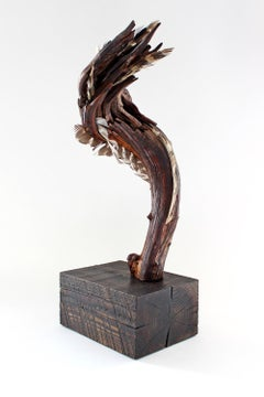"""Ascending Flourish"", sculpture, wood, mountain laurel, feather, browns, reds"