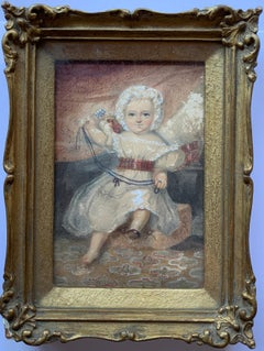 Victorian Portrait of little baby Girl or Child playing with her toys