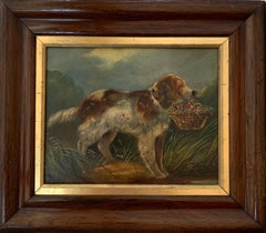 English Victorian portrait of a Spaniel dog holding a  basket of flowers.